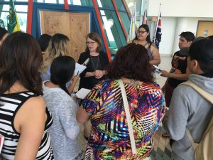 On assignment: students scrum a cabinet minister